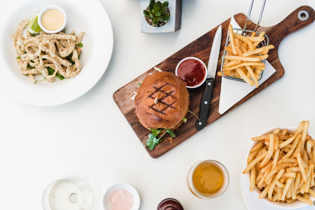 fries and meat on chopping board